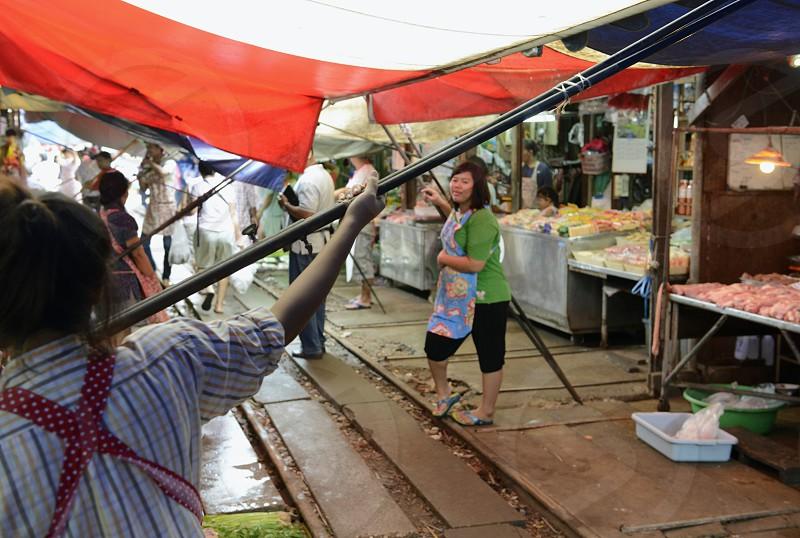 Der Maeklong Railway Markt beim Maeklong Bahnhof ausserhalb der Hauptstadt Bangkok von Thailand in Suedostasien. photo