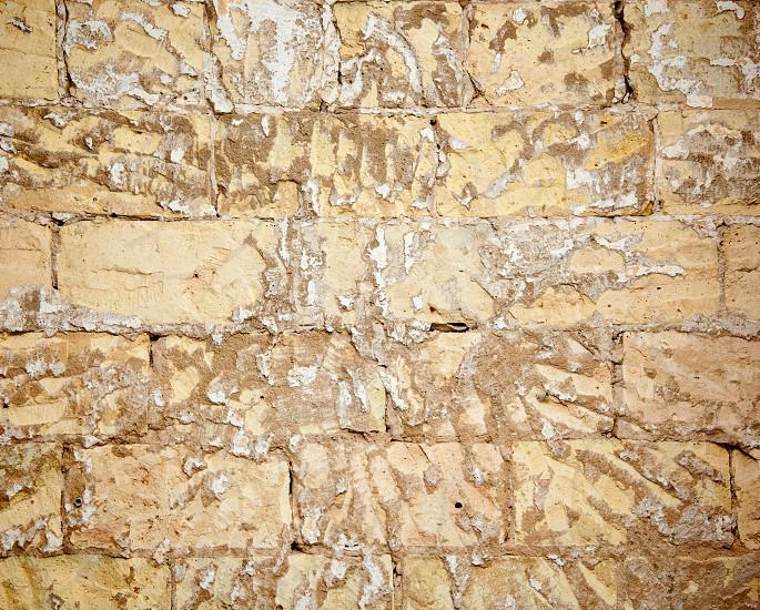 brick wall grunge scraped brickwall to restore the mortar plaste photo