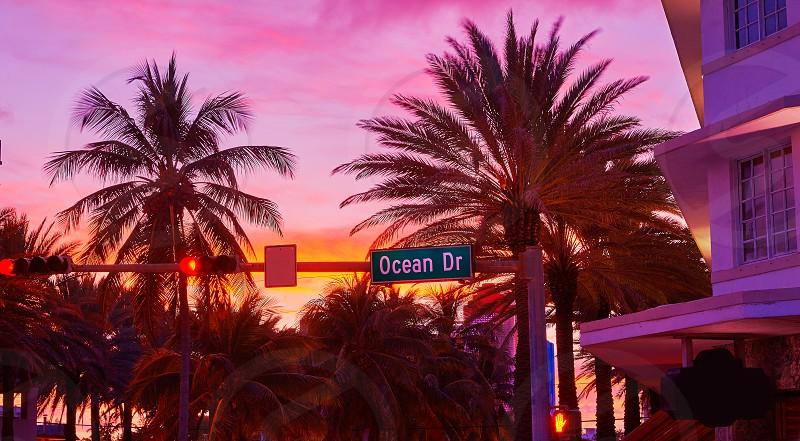 Miami Beach South Beach sunset in Ocean Drive sign Florida photo