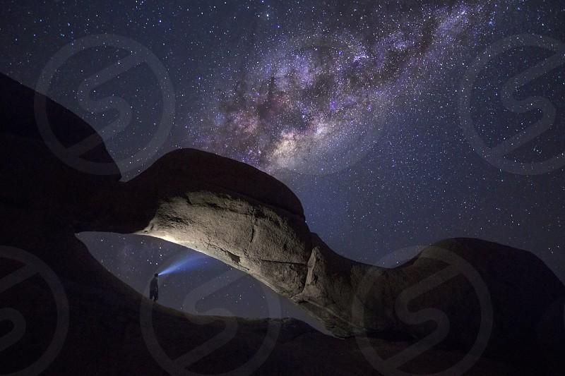 Milky Way stars Astrophotography Botswana light painting night midnight blue Africa constellation evening night arid Namibia Spitzkoppe Boulder granite rock arch  photo