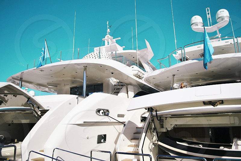 Luxury Super Yachts Parked in a Beautiful Sunny Marina in Fort Lauderdale Florida photo