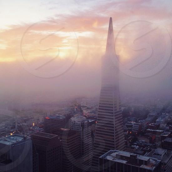 sky scraper cloaked in clouds photo