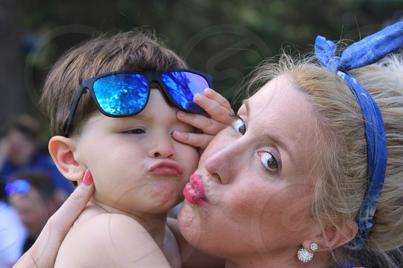 Momma and son playing kissie face glam skin scarf photo