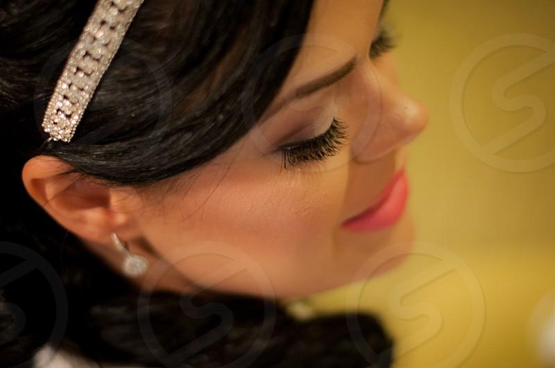 woman in silver diamond studded earrings photo