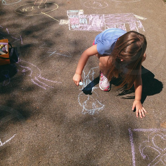 girl touching concrete floor photo