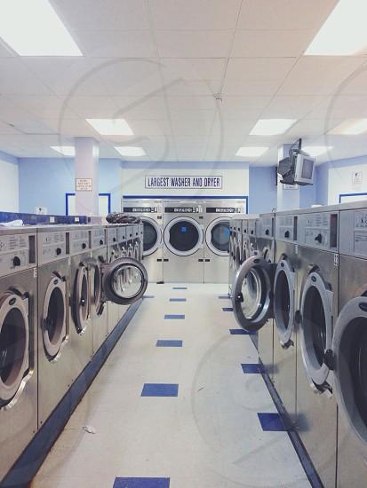 silver front load washing machine  photo