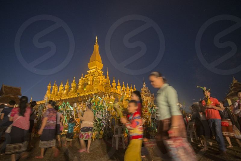 People at a ceremony at the Pha That Luang Festival in the city of vientiane in Laos in the southeastasia. photo