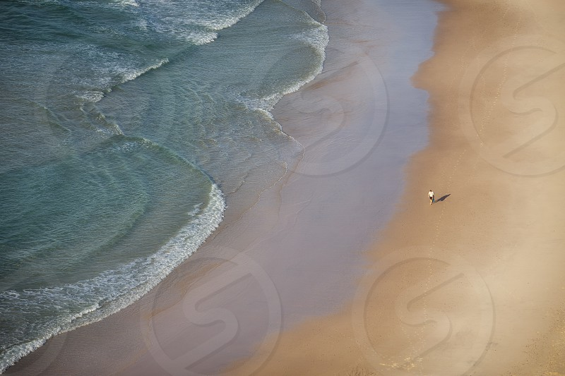 Man walking along the beach photo