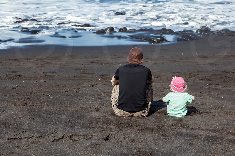 Dad and Daughter Watching the Waves photo