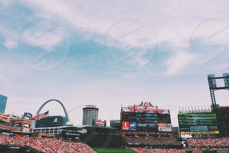 stadium under blue sky during daytime photo photo