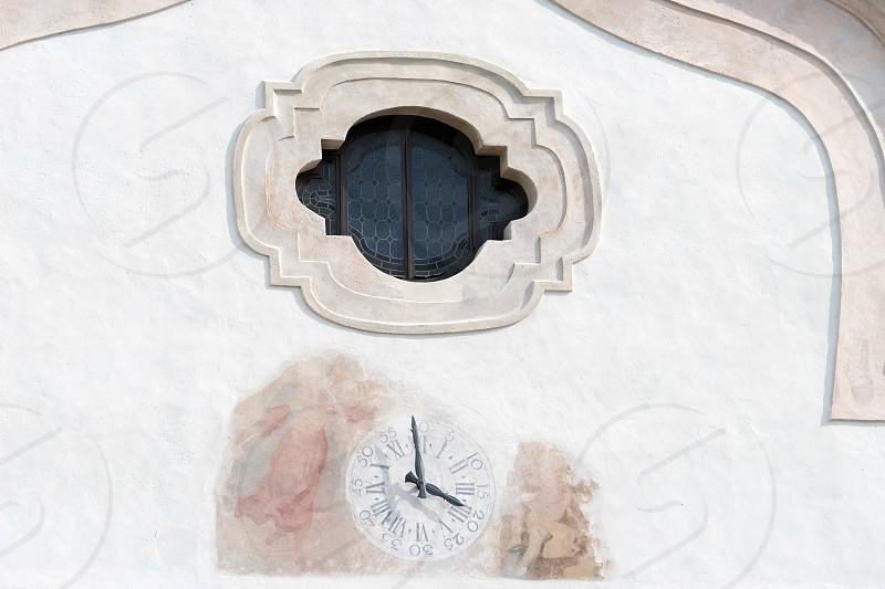 Clock at SS Philip and Jacob Parish Church in Cortina d'Ampezzo photo