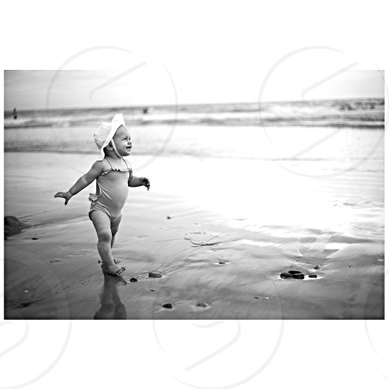 girl standing at sea shore photo