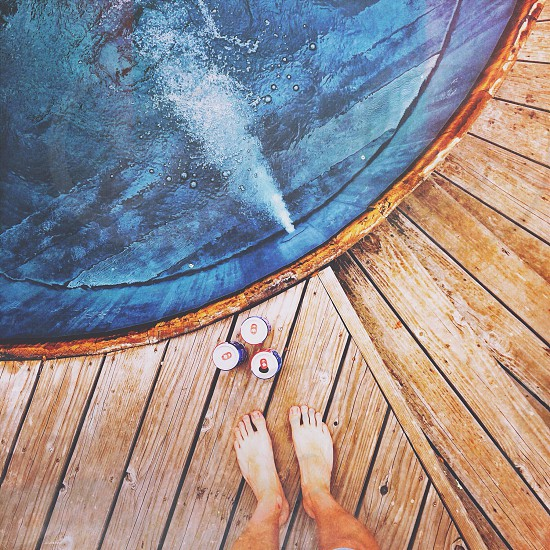 person standing on wooden tub photo