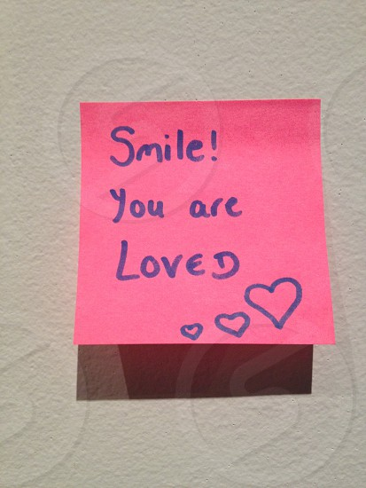 pink sticky paper with smile you are loved print stick on wall photo