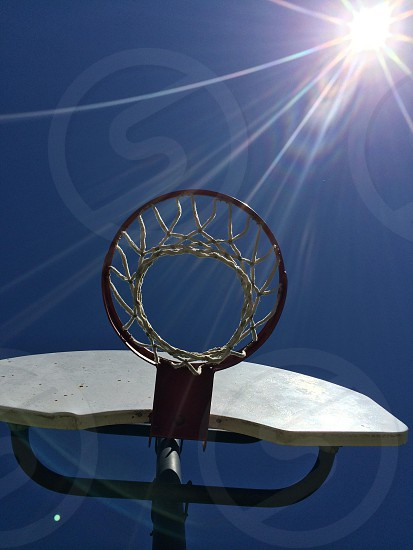 Lens flare on the basketball court photo