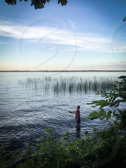 Boy fishing in the lake  photo