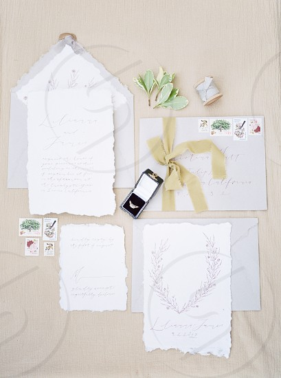 Wedding invitations with stamps rings and ribbon photo