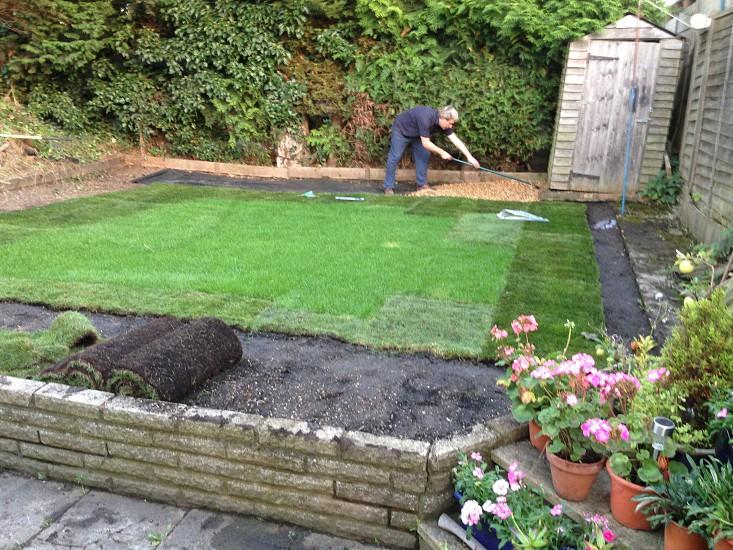Lawn landscaping garden male soil turf  photo