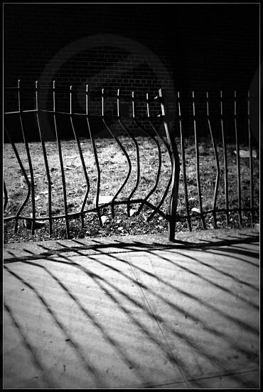 black steel broken fence photo