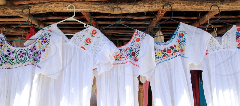 chiapas mayan white dress embroided with flowers photo