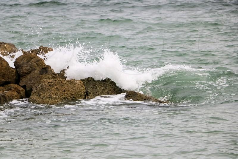 Waves crashing on the rocks photo