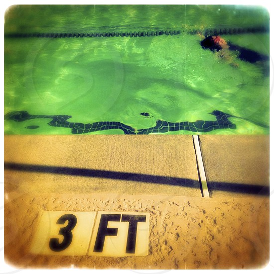 girl swimming in a pool photo