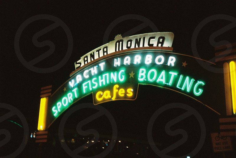 santa monica yacht harbor sport fishing boating cafes neon sign during night time photo