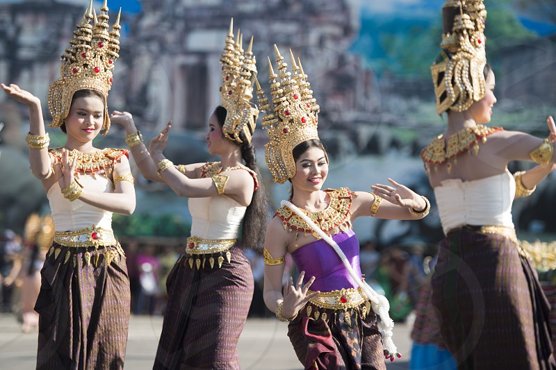 traditional Thai Dance at the Elephant Square in the city centre of Surin at the Elephant Round-up Festival in the city of Surin in Northeastern Thailand in Southeastasia.  photo