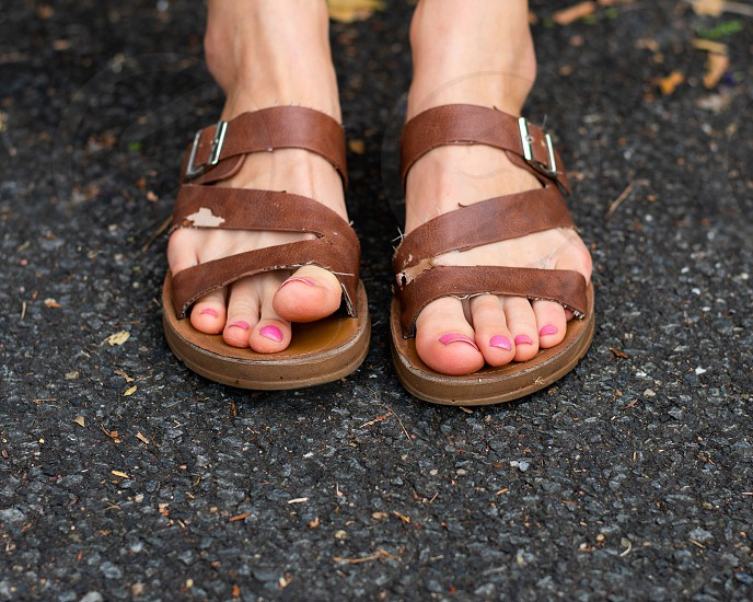 Girl's bare feet with pink nail polish photo