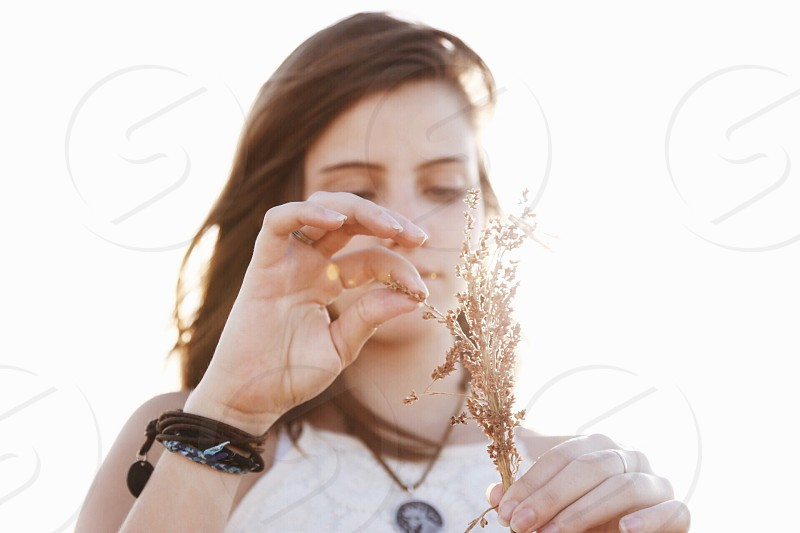 woman holding brown leaf photo