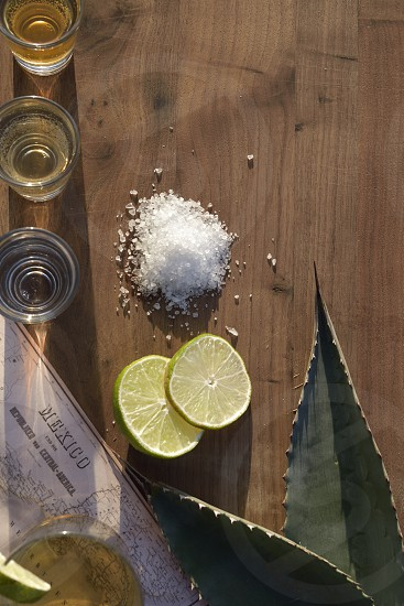 Triple Tequila salt lime Mexico map agave leaves. photo