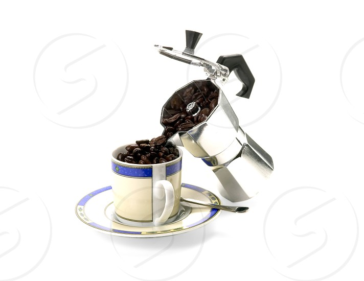 cofee beans cup puored from coffee machine photo