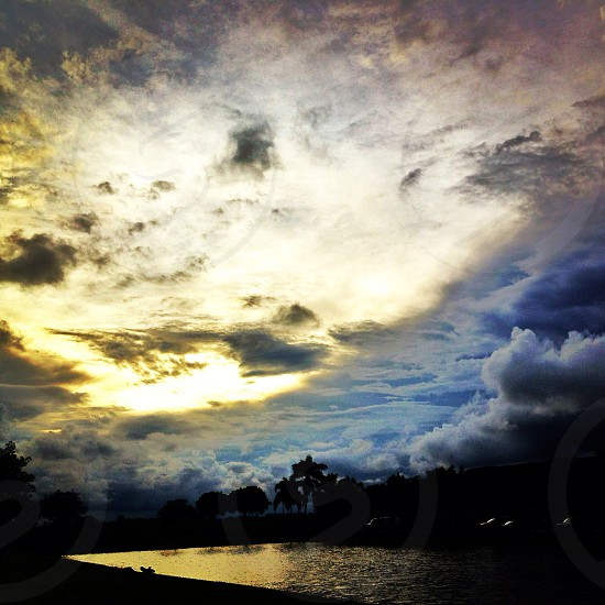 photography of blue collide by yellow sky view photo