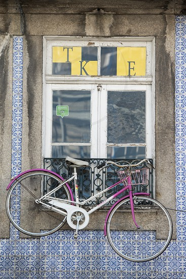a bicycle on a house in the old town of Ribeira in the city centre of Porto in Porugal in Europe. photo