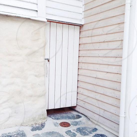 white wooden door and white black floor photo
