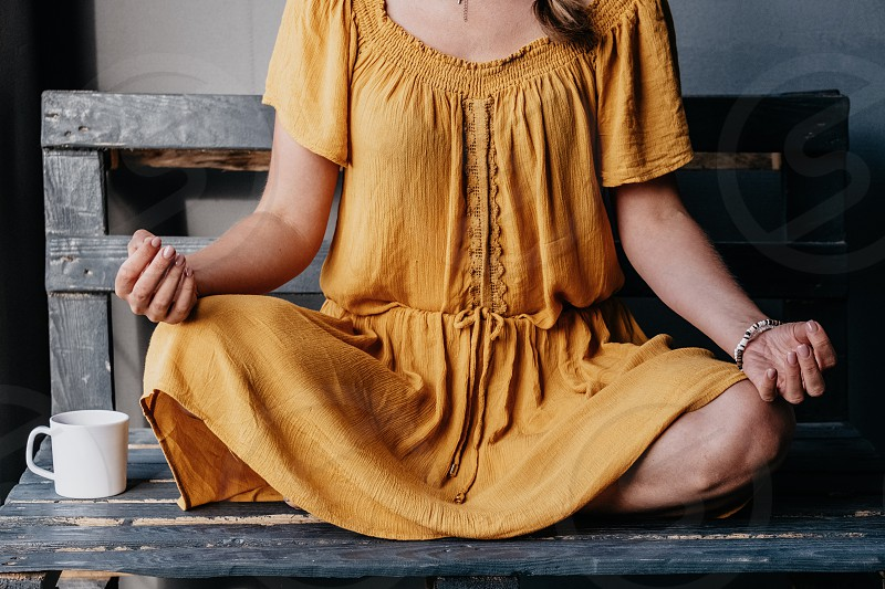 Room dress human person young indoors fashion model beautiful sit adult one girl woman people millennial millennial life healthy healthy lifestyle calm orange color morning morning ritual yoga yoga position relaxing doing yoga meditation photo