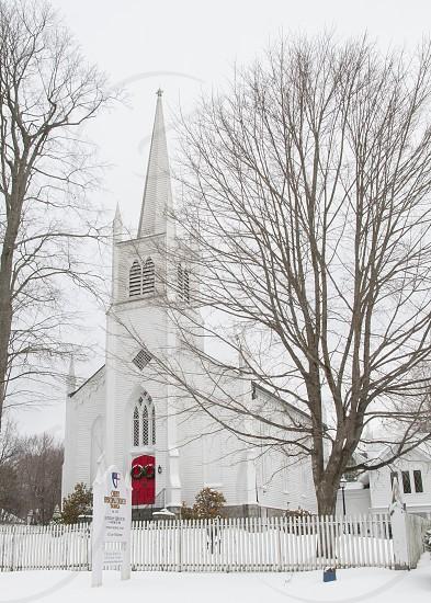 New England Church - red door - Snow photo