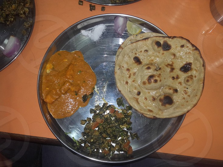 indian food...paneer and bhinddi with tanduri roti. photo