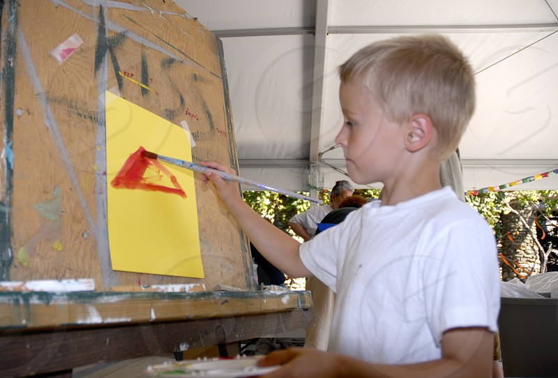 Blonde boy at easel photo