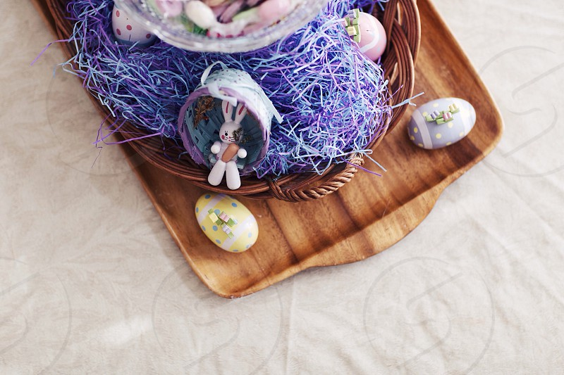 white rabbit figurine on brown woven basket photo