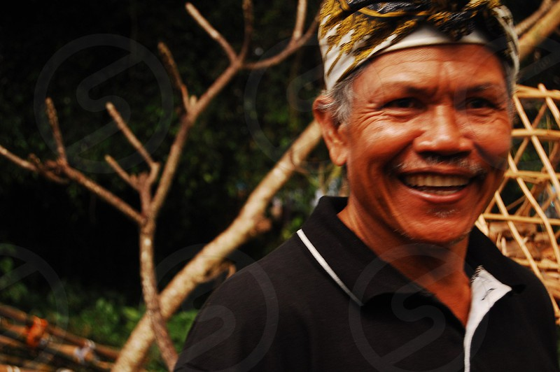 smiling elderly Balinese man photo