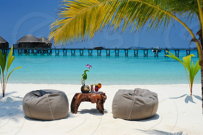 gray bean bags on white beach sand photo