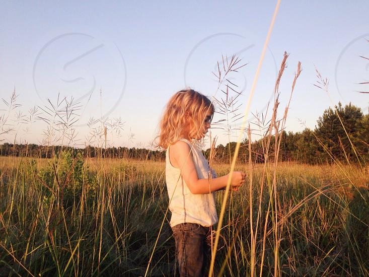 girl in a green grass field photo