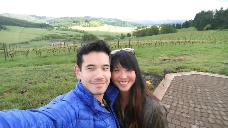 man in blue puff jacket beside woman in brown jacket photo