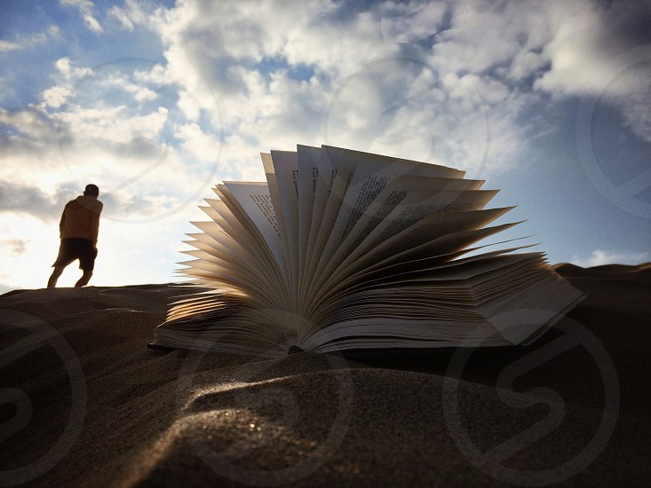 open book on sand photo