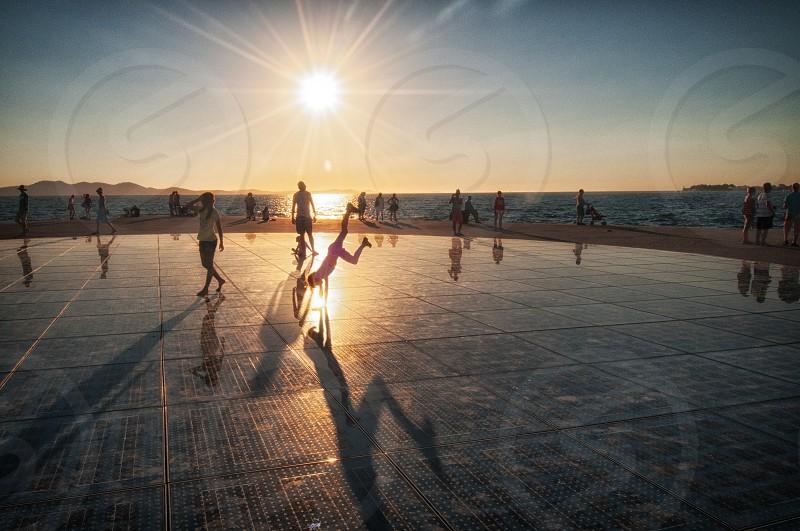sun solstice zadar croatia silhoutte sunset photo