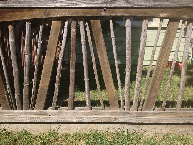 brown wooden fence and green grass photo