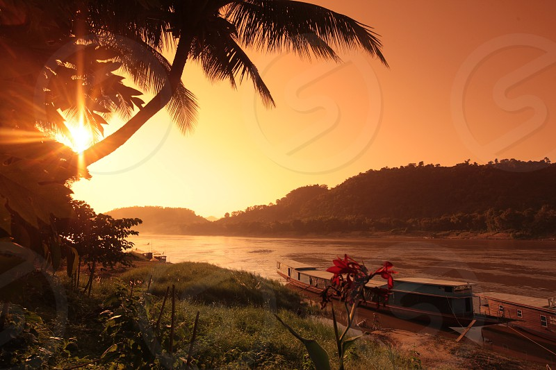 a transport ferry Boat on the Mekong River near Luang Prabang in the north of Lao in Souteastasia. photo