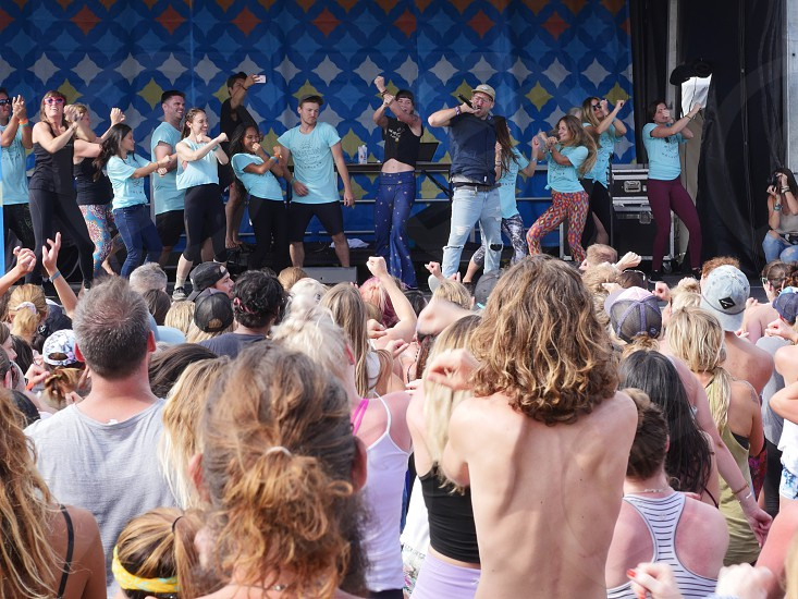 crowd of people cheering happy at a festival photo