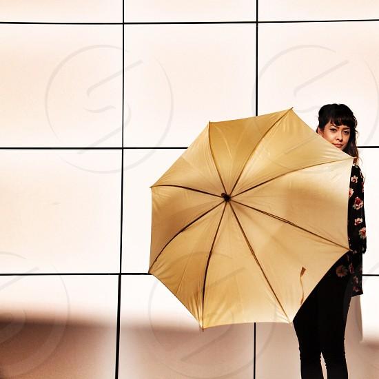 woman holding gold umbrella photo
